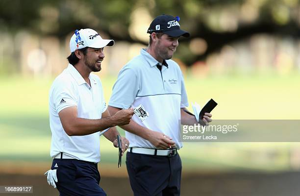 Australians Jason Day and Marc Leishman walk off the 10th green during the first round of the RBC Heritage at Harbour Town Golf Links on April 18...