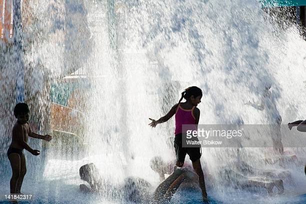 AUSTRALIA-Queensland-NORTH COAST-Townsville: Children playing at the Water Fun Park by the Tobruk Pool