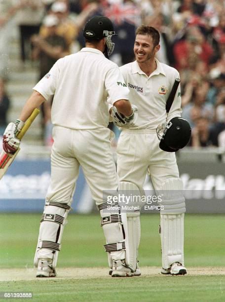 Australia's Adam Gilchrist congratulates fellow century maker Damien Martyn after he hit his maiden Test 100 against England at Edgbaston