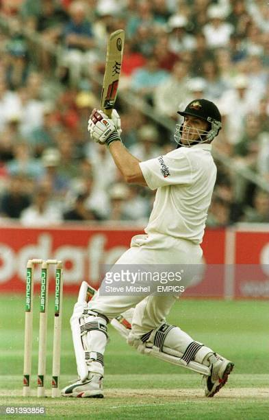 Australia's Adam Gilchrist hits the boundary that brings up his century against England at Edgbaston