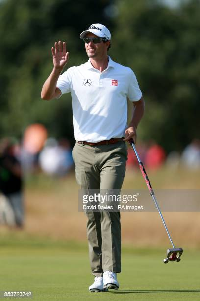 Australia's Adam Scott celebrates after he puts for a birdie on the 9th hole during day one of the 2014 Open Championship at Royal Liverpool Golf...