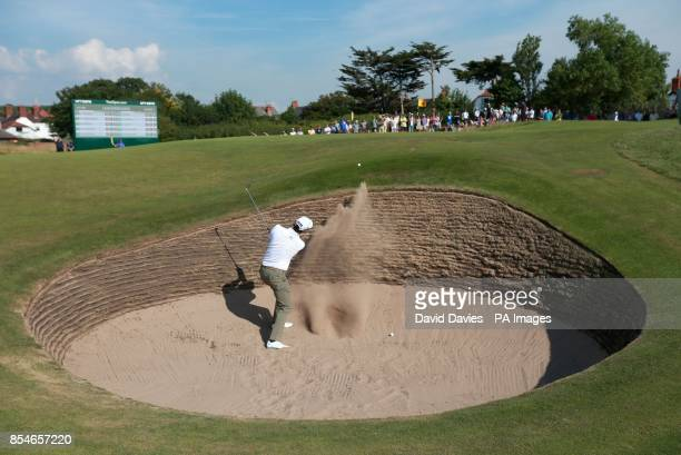 Australia's Adam Scott chips out of a bunker on the 10th hole during day one of the 2014 Open Championship at Royal Liverpool Golf Club Hoylake