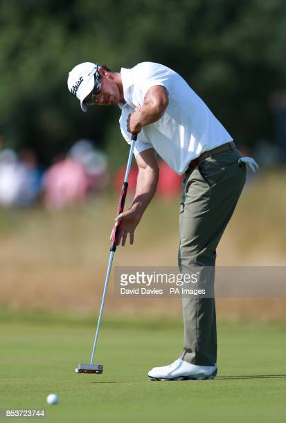 Australia's Adam Scott puts for a birdie on the 9th hole during day one of the 2014 Open Championship at Royal Liverpool Golf Club Hoylake