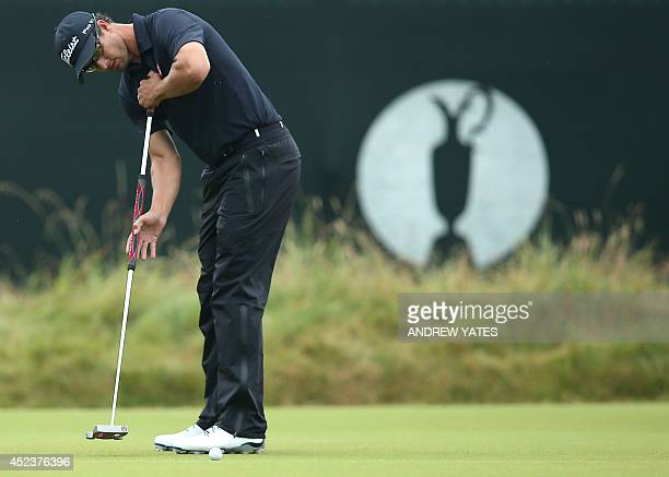 Australia's Adam Scott putts on the 3rd green during his third round on day three of the 2014 British Open Golf Championship at Royal Liverpool Golf...