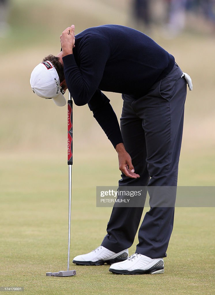 Australia's Adam Scott reacts after dropping a shot on the 13th green during the fourth and final round of the 2013 British Open Golf Championship at Muirfield golf course at Gullane in Scotland on July 21, 2013 .