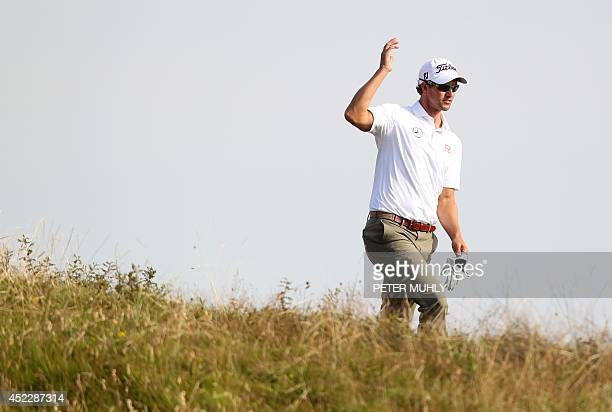 Australia's Adam Scott runs to the 14th green during his first round 68 on the opening day of the 2014 British Open Golf Championship at Royal...
