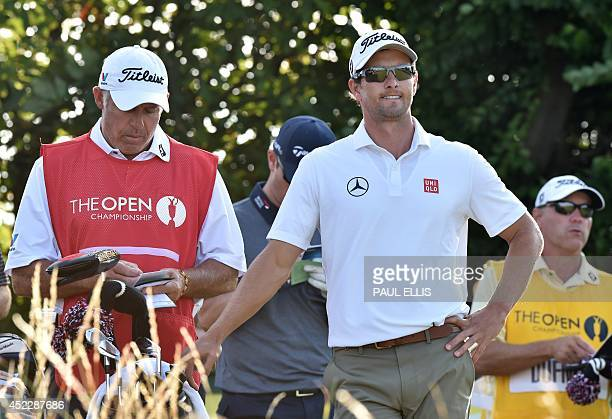 Australia's Adam Scott waits on the 17th green during his first round 68 on the opening day of the 2014 British Open Golf Championship at Royal...