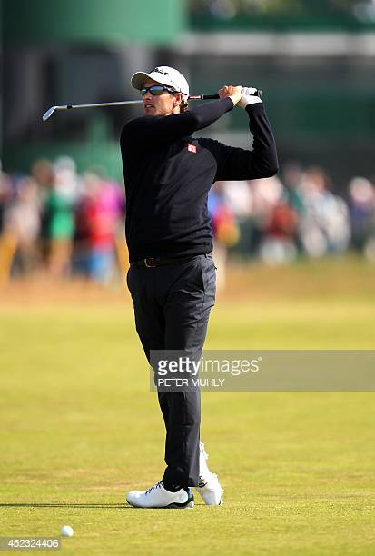 Australia's Adam Scott watches his approach shot to the 3rd green during his second round on day two of the 2014 British Open Golf Championship at...