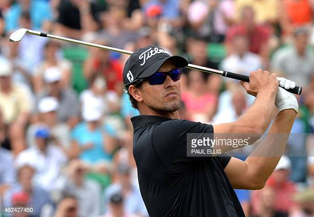 Australia's Adam Scott watches his shot from the 4th tee during his fourth round on the final day of the 2014 British Open Golf Championship at Royal...