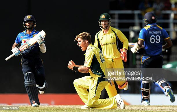 Australia's Adam Zampa celebrates with wicketkeeper Matthew Wade after he dismissed Sri Lankan batsman Kusal Mendis during the second oneday...