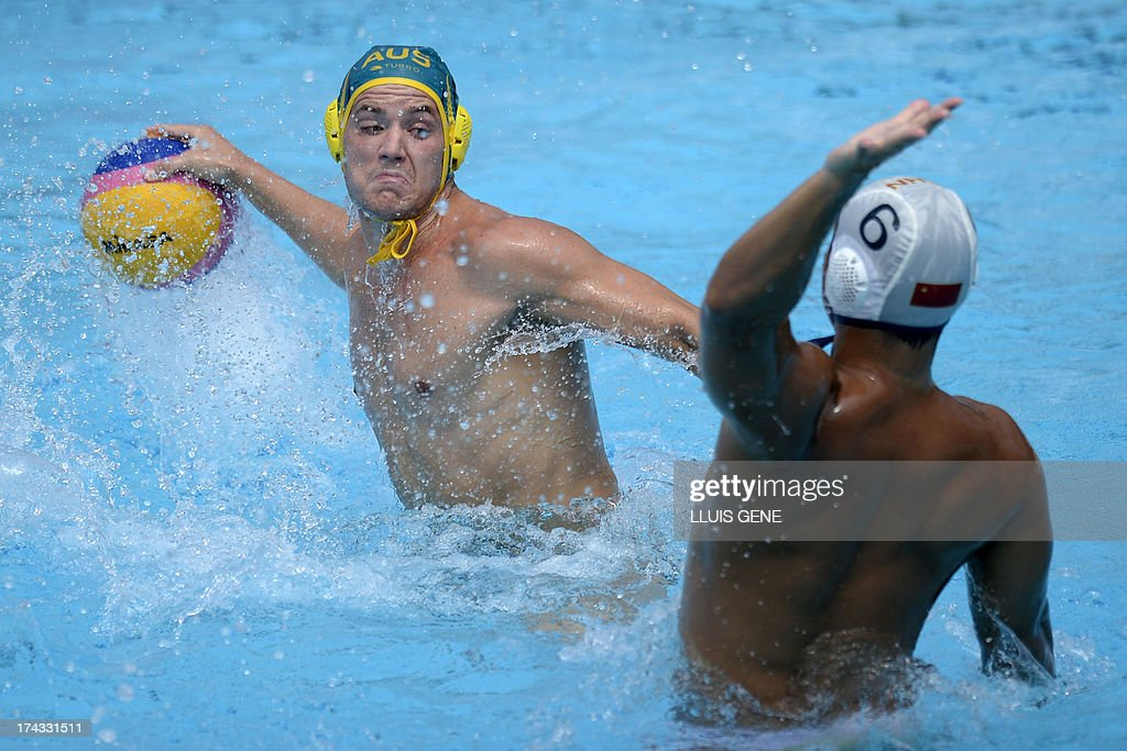 Australia's Aidan Roach (L) vies with China's Pan Ning (R) during the preliminary round match of the men's water polo competition between China and Australia at the FINA World Championships at the Bernat Picornell swimming pool in Barcelona on July 24, 2013. AFP PHOTO/ LLUIS GENE