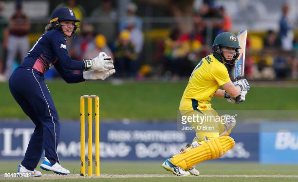 Australia's Alex Blackwell plays a shot as Sarah Taylor looks on during the Women's One Day International between Australia and England at Allan...