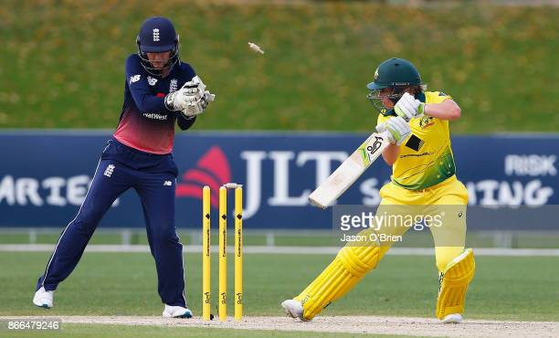 Australia's Alyssa Healy is bowled as England's Sarah Taylor looks on during the Women's One Day International match between Australia and England on...