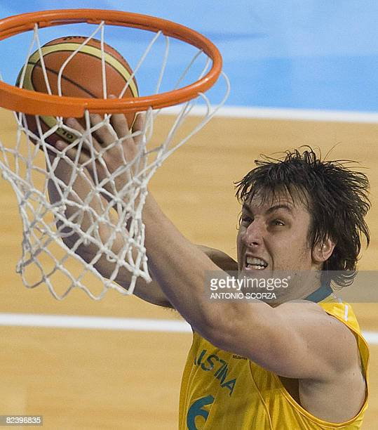 Australia's Andrew Bogut jumps to score against Lithuania during their men's preliminary round group A basketball at the Olympic Basketball Arena...