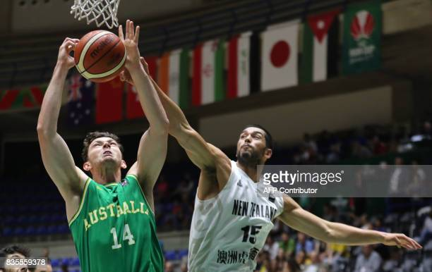 Australia's Angus Brandt plays against New Zealand's Dyson KingHawea during their 2017 FIBA Asia Cup semifinal basketball match in the Lebanese town...