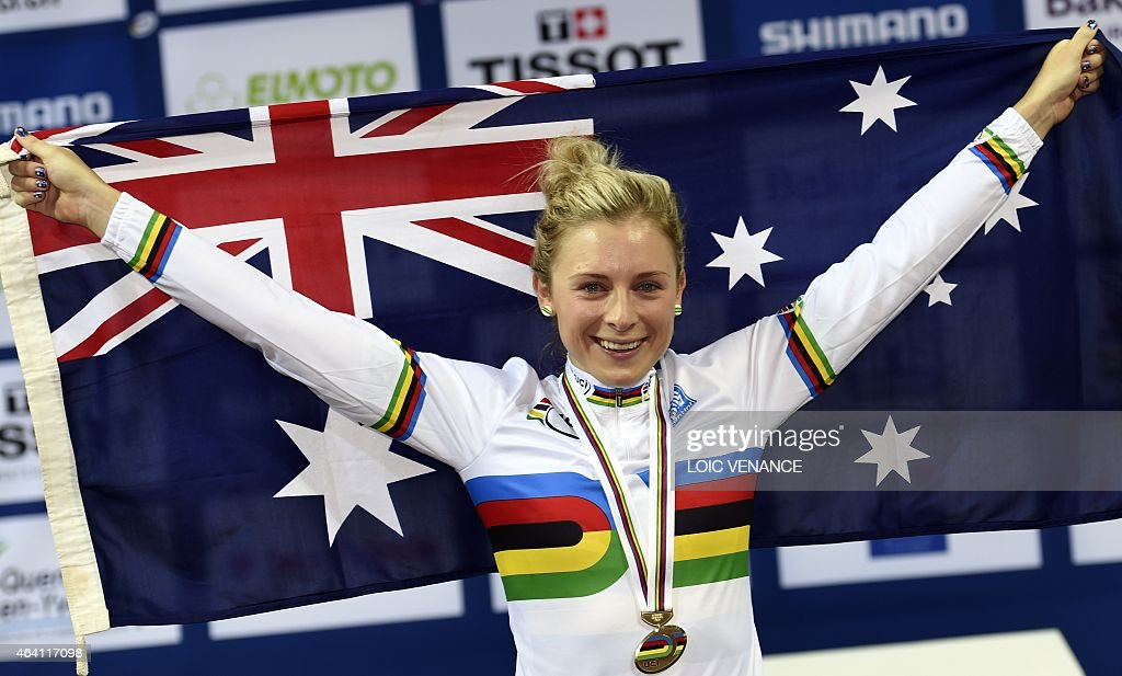 Australia's <a gi-track='captionPersonalityLinkClicked' href=/galleries/search?phrase=Annette+Edmondson&family=editorial&specificpeople=4872666 ng-click='$event.stopPropagation()'>Annette Edmondson</a> celebrates on the podium with an Australian flag after coming in first in the Women's Omnium competition at the UCI Track Cycling World Championships in Saint-Quentin-en-Yvelines, near Paris, on February 22, 2015.