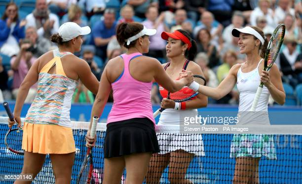 Australia's Ashleigh Barty and Casey Dellacqua shake hands with Chinese Taipei's Yungjan Chan and Switzerland's Martina Hingis after the Women's...