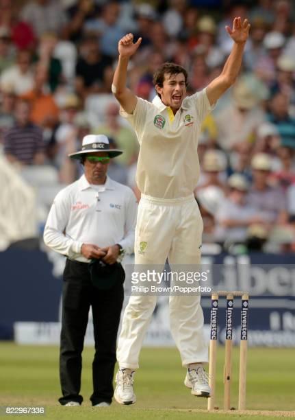 Australia's Ashton Agar celebrates after England batsman Stuart Broad edged the ball to be caught by Australia's Michael Clarke only for umpire Aleem...