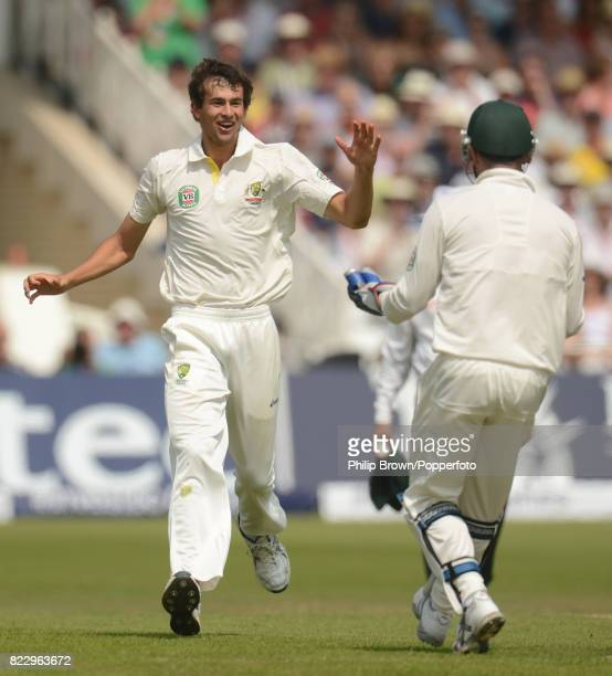 Australia's Ashton Agar celebrates with teammate Brad Haddin after taking his first Test wicket England captain Alastair Cook for 50 runs in the 1st...