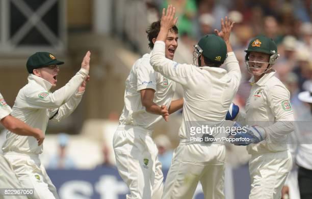 Australia's Ashton Agar celebrates with teammates Chris Rogers Ed Cowan and Brad Haddin after taking his first Test wicket England captain Alastair...