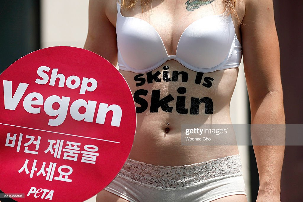 Australia's associate director, Ashley Fruno with 'Skin is Skin' written across her torso and holding a sign reading 'shop vegan' takes to the streets outside a Prada store on May 25, 2016 in Seoul, South Korea. The supporters of PETA Asia protested in front of Prada store against the retailer's ostrich-leather use.