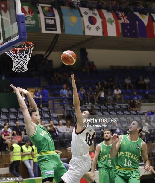 Australia's basketball team player Brandt Angus tries to block the ball as his team plays against Japan during the FIBA AsiaCup 2017 in the Lebanese...