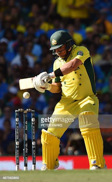Australia's batman David Warner hits a four during the 2015 Cricket World Cup semifinal match between Australia and India in Sydney on March 26 2015...