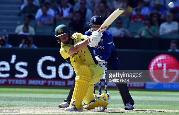 Australia's batsman Aaron Finch plays for a boundary off England's Joe Root as England's wicketkeeper Jos Buttler looks on during the Pool A 2015...