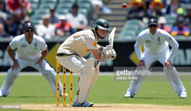 Australia's batsman Chris Rogers ducks to avoid a bouncer off England's paceman James Anderson during the first day of the second Ashes Test cricket...