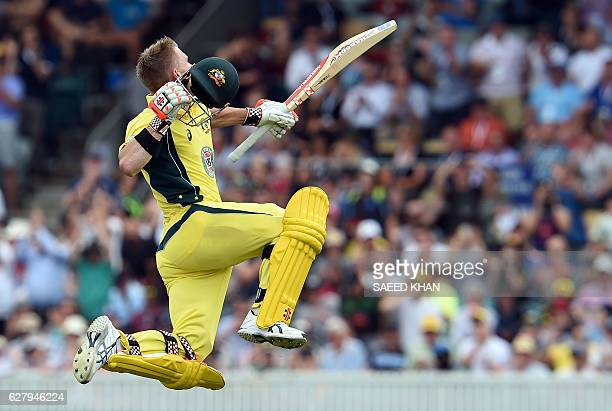 TOPSHOT Australia's batsman David Warner celebrates his 100runs during the second game of the One Day International Cricket series between Australia...