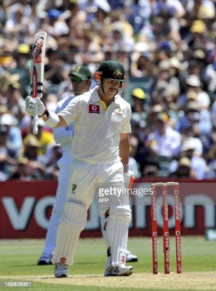 Australia's batsman David Warner celebrates his 50 runs batting against South Africa on the first day of the second Test match at the Adelaide Oval...
