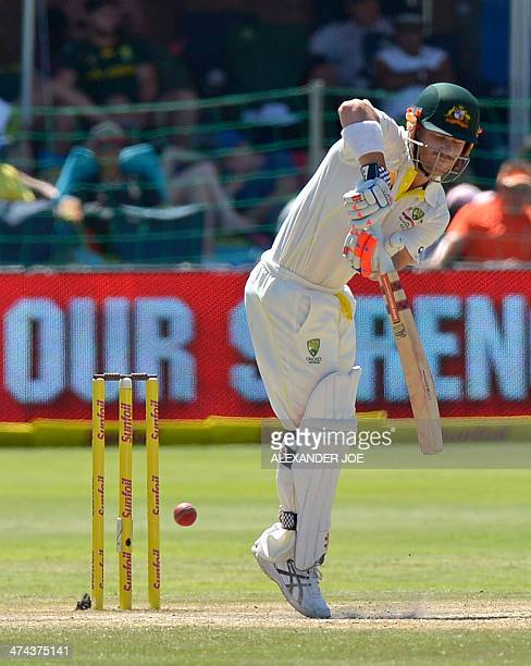 Australia's batsman David Warner plays a shot during Australia's second innings in the second test match between South Africa and Australia at St...