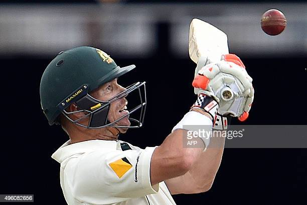 Australia's batsman David Warner plays a shot during day three of the first Test cricket match between Australia and New Zealand in Brisbane on...