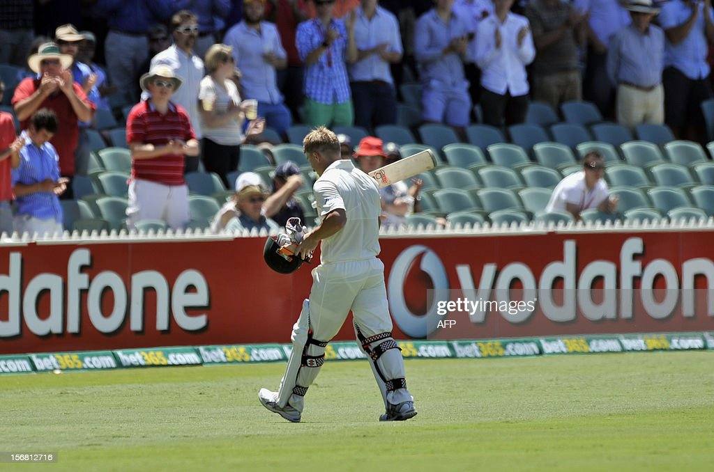 Australia's batsman David Warneris walks off after being dismissed against South Africa on the first day of the second cricket Test match at the Adelaide Oval on November 22, 2012. AFP PHOTO/David Mariuz IMAGE STRICTLY FOR EDITORIAL USE - STRICTLY NO COMMERCIAL USE