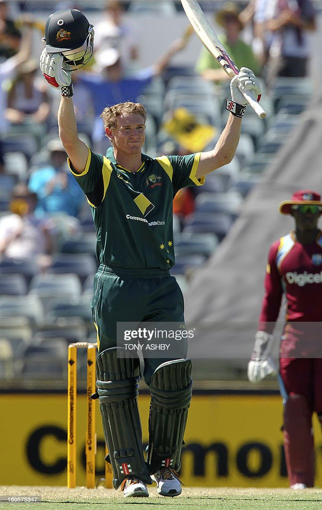 Australia's batsman George Bailey celebrates his century during the one-day international cricket match between Australia and the West Indies at the WACA ground in Perth on February 3, 2013. AFP PHOTO/Tony ASHBY USE