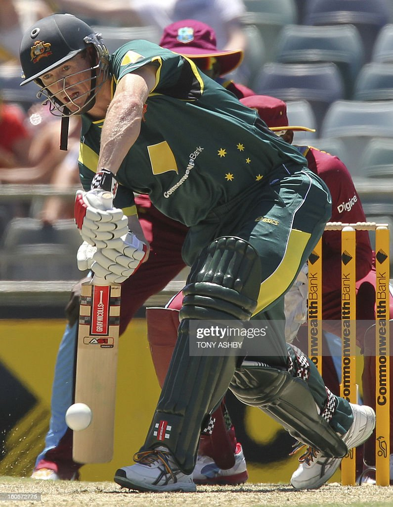 Australia's batsman George Bailey drives during the one-day international cricket match between Australia and the West Indies at the WACA ground in Perth on February 3, 2013. AFP PHOTO/Tony ASHBY IMAGE