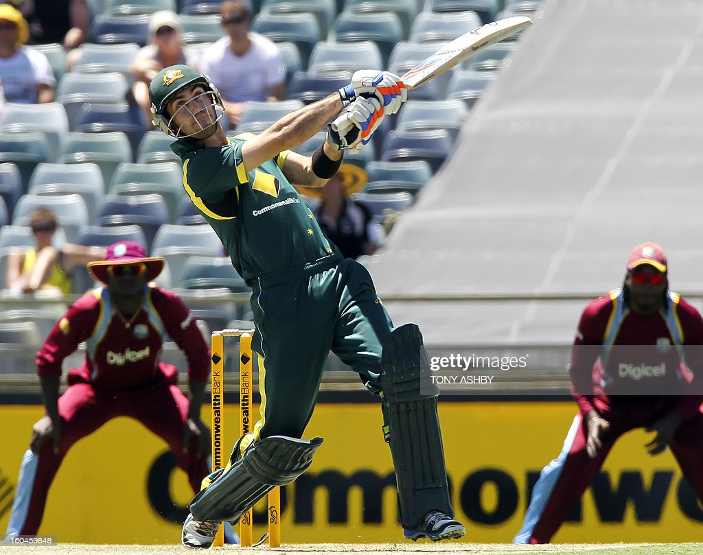 Australia's batsman Glenn Maxwell slogs a ball over the boundary for six runs during the one-day international cricket match between Australia and the West Indies at the WACA ground on February 1, 2013. AFP PHOTO/Tony ASHBY IMAGE