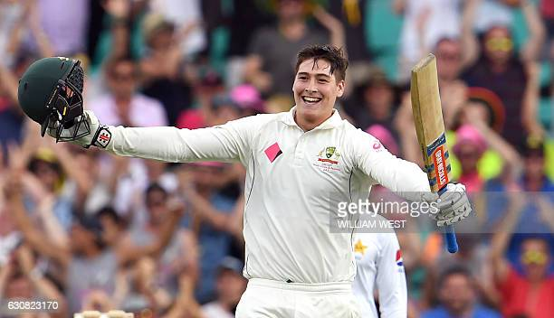 Australia's batsman Matt Renshaw celebrates scoring his century against Pakistan during the first day of the third cricket Test match at the SCG in...