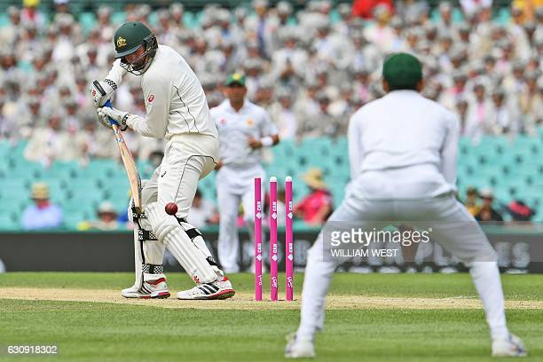 Australia's batsman Matt Renshaw is bowled by Pakistan's Imran Khan on the second day of the third cricket Test match at the SCG in Sydney on January...