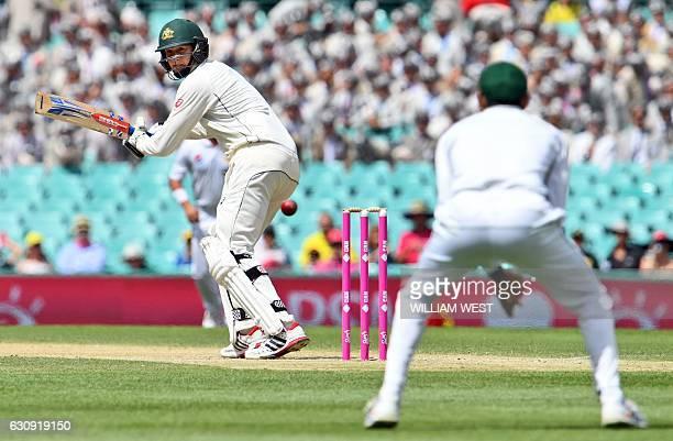 Australia's batsman Matt Renshaw snicks a ball to Pakistan's fieldsman Younis Khan on the second day of the third cricket Test match at the SCG in...