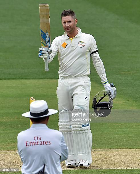 Australia's batsman Michael Clarke celebrates after reaching his century on the second day of the first Test cricket match between Australia and...