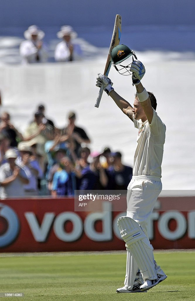 Australia's batsman Michael Clarke celebrates his 100 runs against South Africa on the first day of the second cricket Test match at the Adelaide Oval on November 22, 2012. AFP PHOTO/David Mariuz IMAGE
