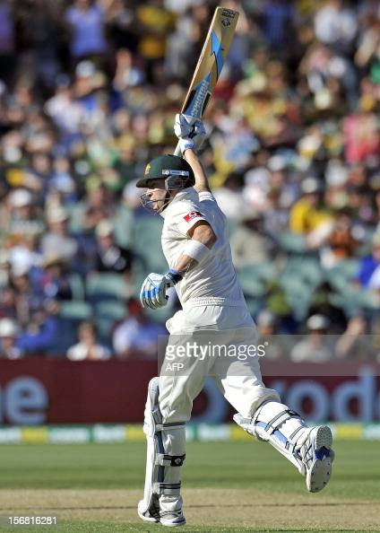 Australia's batsman Michael Clarke celebrates his 200 runs against South Africa on the first day of the second cricket Test match at the Adelaide...