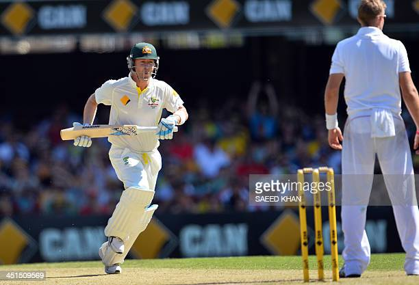 Australia's batsman Michael Clarke runs to complete his 100 runs during day three of the first Ashes cricket Test match between England and Australia...