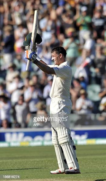 Australia's batsman Mike Hussey celebrates his 100 against South Africa on the first day of the second cricket Test match at the Adelaide Oval on...
