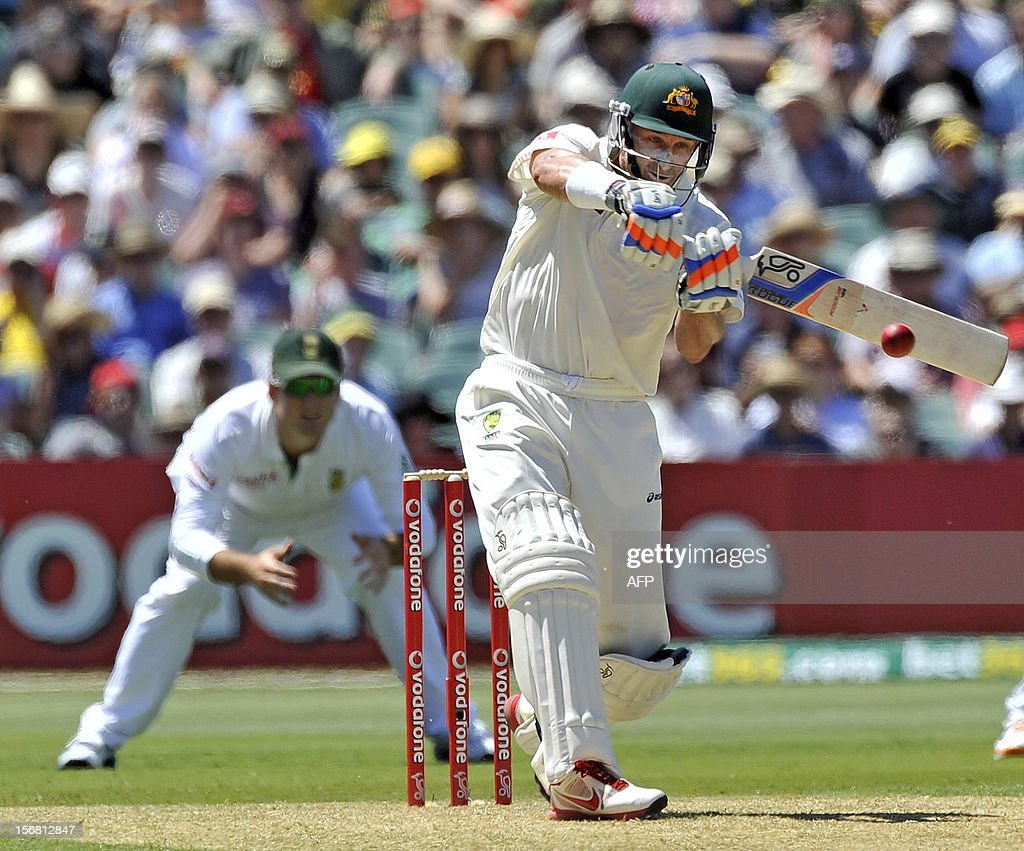 Australia's batsman Mike Hussey (R) hits a ball against South Africa on the first day of the second cricket Test match at the Adelaide Oval on November 22, 2012. AFP PHOTO/David Mariuz IMAGE STRICTLY FOR EDITORIAL USE - STRICTLY NO COMMERCIAL USE