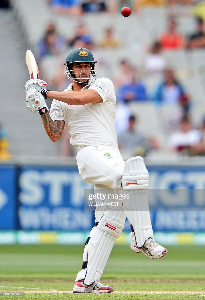Australia's batsman Mitchell Johnson pulls a delivery from the Sri Lankan bowling on the second day of the second cricket Test match at the Melbourne Cricket Ground (MCG) on December 27, 2012. AFP PHOTO/William WEST USE