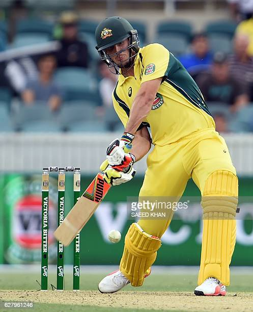 Australia's batsman Mitchell Marsh executes a hit over the boundary for six runs off New Zealand's paceman Matt Henry during the second game of the...