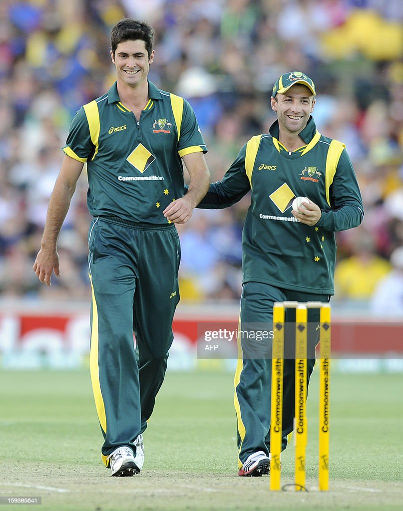 Australia's Ben Cutting (L) and Phillip Hughes share a laugh during their one-day international cricket match against Sri Lanka at the Adelaide Oval on January 13, 2013. AFP PHOTO / David Mariuz USE