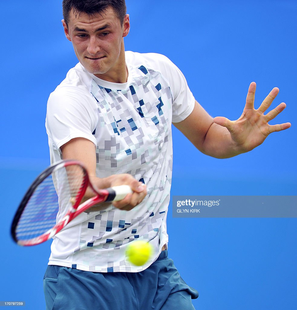 Australias Bernard Tomic against Britains James Ward during his men's singles match on the fourth day of the AEGON International tennis tournament in Eastbourne, southern England on June 18, 2013.